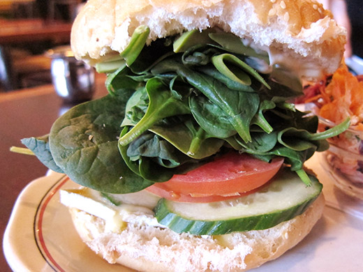 Perch's Brie Melt ($10) stacked with brie, avocado, cucumber, tomato, spinach, mayo on a kaiser bun.