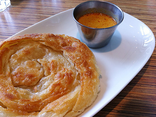 Roti Canai ($3.95): Malaysian style crispy bread with a side of yellow curry sauce.