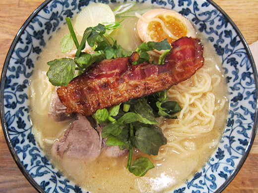 Harvest's take on the Japanese classic Ramen topped with a slice of candied bacon.