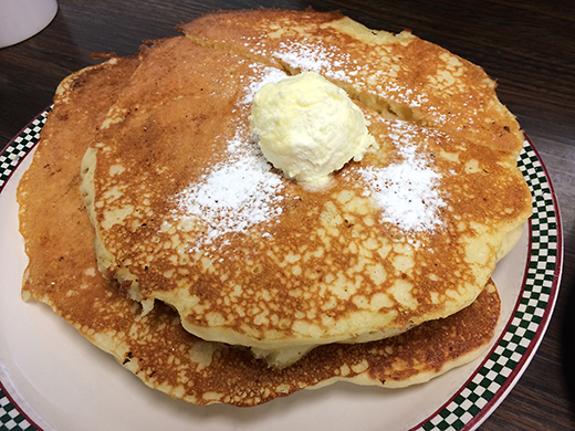 Short stack of Buttermilk Pancakes ($5) -- served with whipped butter and warm maple syrup.