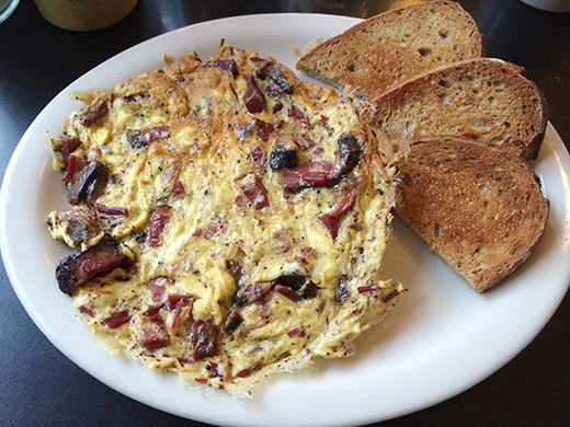 Beef Pastrami and 3 eggs served frittata style ($11.95)