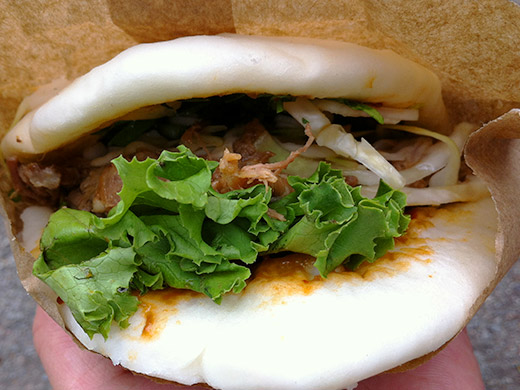 Le Tigre's Steamed Bun with BBQ Pulled Pork ($4.25) stuffed with cabbage slaw, cilantro, basil, and sweet chilli bean sauce.