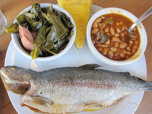 Smoked Whole Ruby Trout ($12) served with side of Collard Greens, BBQ Beans and a wedge of corn bread.