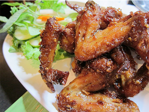 Ike's Vietnamese Fish Sauce Wings ($14): half dozen chicken wings marinated in fish sauce and sugar, then deep fried, tossed in caramelized Phu Quoc fish sauce and garlic.