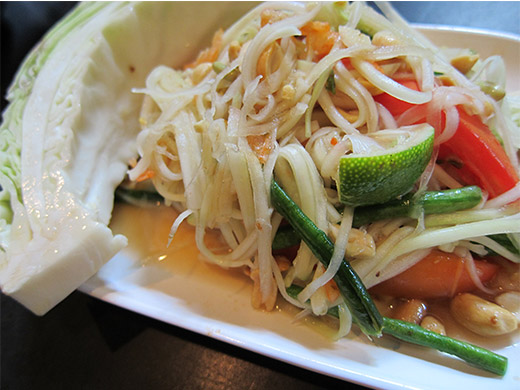Papaya PokPok ($9): Spicy green papaya salad tossed with tomatoes, long beans, Thai chili, lime juice, tamarind, fish sauce, garlic, palm sugar, dried shrimp, and peanuts. Made to order in the poke pok (mortar and pestle).