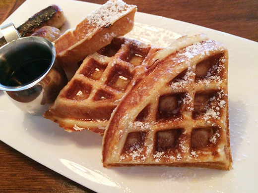 Belgian Waffles ($6.75) with melted butter and syrup + English Bangers (+$3).